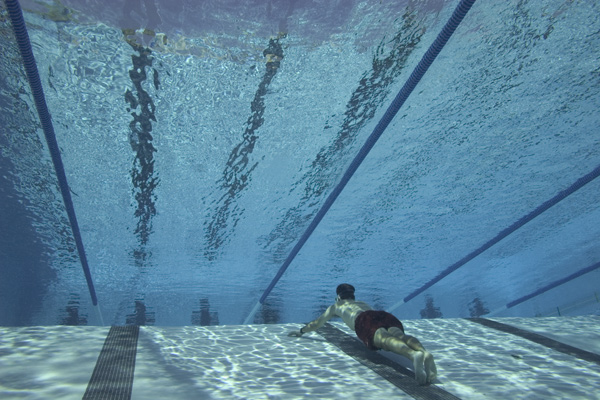 Ben freediving between the lane lines